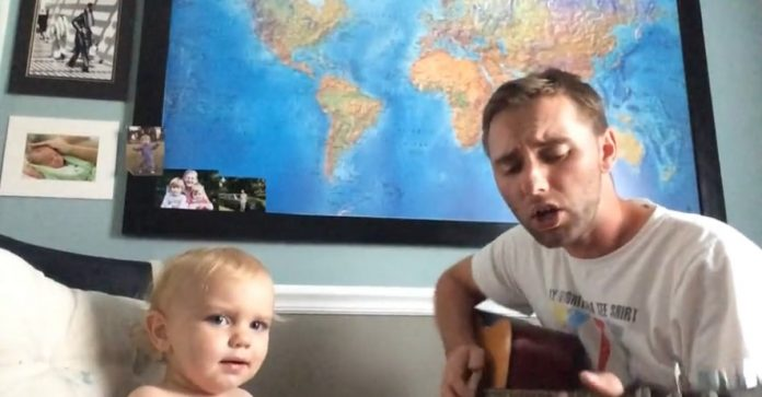 baby sings duet with dad